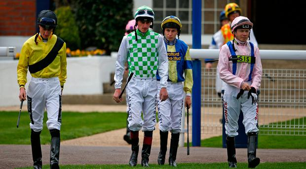 Jockeys make their way to the parade ring ahead of yesterday's opening race at Windsor. Photo: Alan Crowhurst/Getty Images