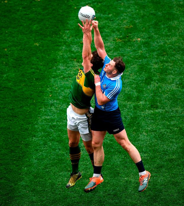 David Moran and Philly McMahon battle for a high ball. Photo: Ray McManus/Sportsfile