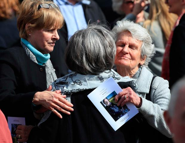 Bob Ryan's widow, Mary (centre) is consoled. Photo: Colin Keegan, Collins Dublin.