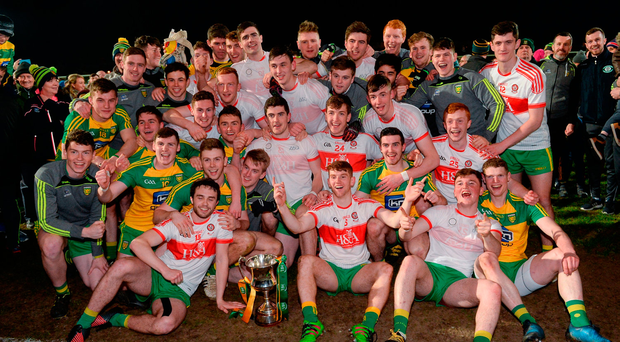 Donegal players celebrate with the Cup
