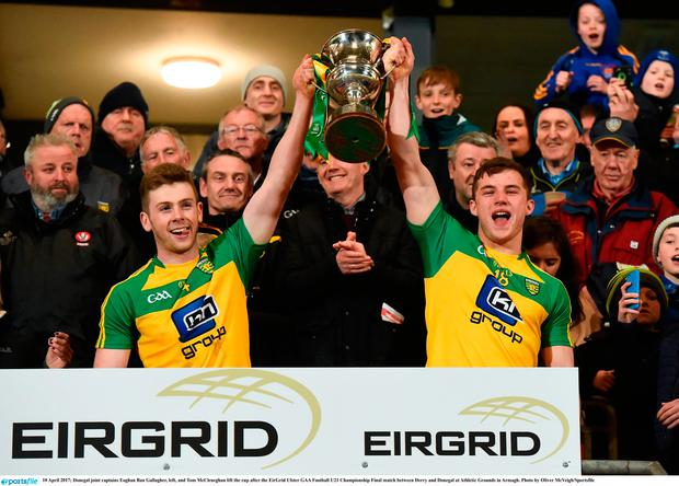Donegal joint captains Eoghan Ban Gallagher, left, and Tom McCleneghan lift the Cup