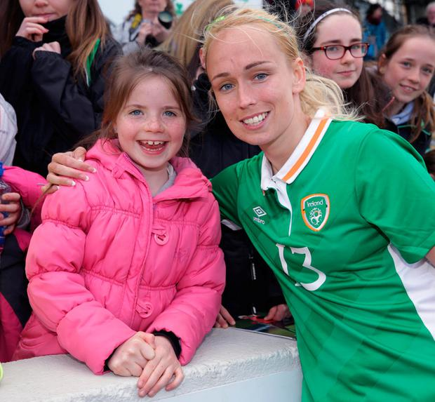 Stephanie Roche smiles with supporter Issy Kearney (7), from Wexford, after victory over Slovakia. Photo: Damien Eagers