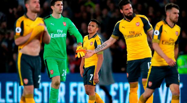 Arsenal's Alexis Sanchez and team-mates appear dejected after the Premier League match at Selhurst Park