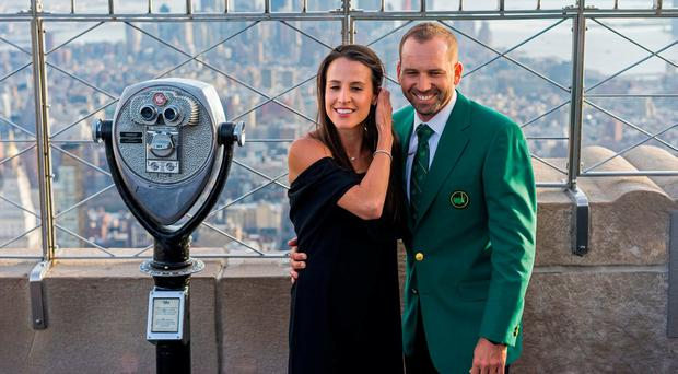 Sergio Garcia, with his fiancee Angela Akins, stands on the 86th floor of the Empire State Building in New York a day after winning the 2017 Masters in Augusta