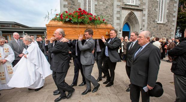 The coffin of former Dublin football captain Denis Mahony is shouldered from St. Sylvester's Church, Malahide following his funeral mass. Pic:Mark Condren 11.4.2017.