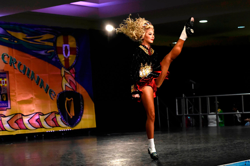 A dancer performs on stage during the World Irish Dancing Championships in Dublin's Citywest Hotel. Photo: Clodagh Kilcoyne/Reuters