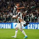TURIN, ITALY - APRIL 11: Paulo Dybala of Juventus celebrates scoring the second goal to make the score 2-0 with Mario Mandzukic during the UEFA Champions League Quarter Final first leg match between Juventus and FC Barcelona at Juventus Stadium on April 11, 2017 in Turin, Italy. (Photo by Chris Brunskill Ltd/Getty Images)