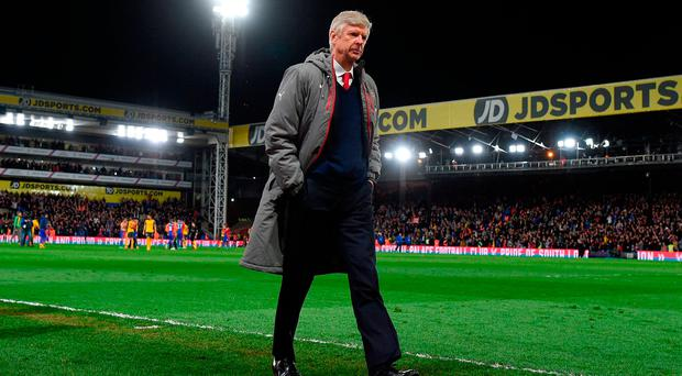 Arsene Wenger cuts a lonely figure after humiliating Crystal Palace loss. Photo: Mike Hewitt/Getty Images