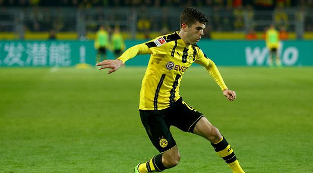 DORTMUND, GERMANY - APRIL 04: Marc Bartra of Dortmund runs with the ball during the Bundesliga match between Borussia Dortmund and Hamburger SV at Signal Iduna Park on April 4, 2017 in Dortmund, Germany. (Photo by Christof Koepsel/Bongarts/Getty Images)