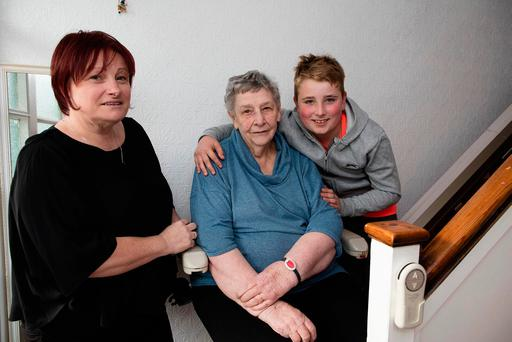 Shirley Thornton and son Lewis with her 83-year-old mother Eva at their home in Mount Merrion, Dublin. Photo: Arthur Carron