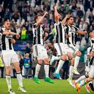 Juventus players celebrate their 3-0 win. Photo: AP Photo/Antonio Calanni