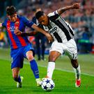 Juventus' Alex Sandro in action with Barcelona's Sergi Roberto. Photo: Stefano Rellandini/Reuters