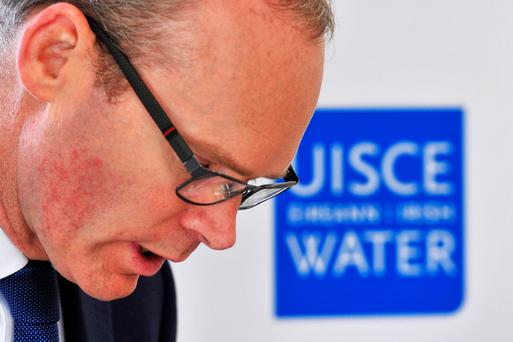 Housing Minister Simon Coveney must now begin work on issuing refunds to one million law-abiding households who had paid money to Irish Water. Photo: Daragh Mc Sweeney/Provision