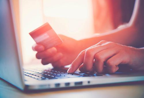 Consumers find it more attractive to shop on UK sites as the fall in the value of sterling relative to the euro makes it cheaper to buy online. Stock Image