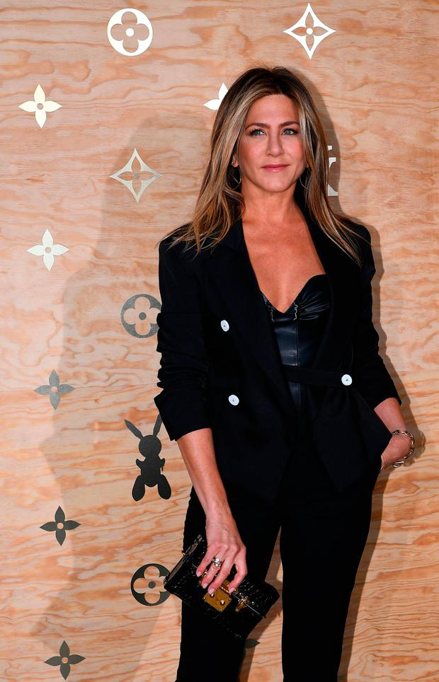 US actress Jennifer Aniston poses during a photocall ahead of a diner for the launch of a Louis Vuitton leather goods collection in collaboration with US artist Jeff Koons, at the Louvre in Paris on April 11, 2017. / AFP PHOTO / GABRIEL BOUYSGABRIEL BOUYS/AFP/Getty Images