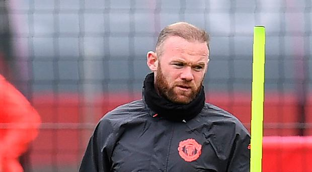 Manchester United's English striker Wayne Rooney takes part in a team training session at their Carrington base in Manchester, north west England, on April 12, 2017, on the eve of their UEFA Europa League quarter-final football match against Anderlecht. / AFP PHOTO / Paul ELLISPAUL ELLIS/AFP/Getty Images