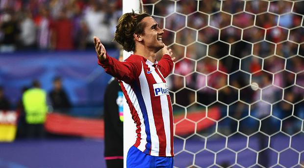 Antoine Griezmann of Atletico Madrid celebrates after scoring his team's first goal of the game from the penalty spot during the UEFA Champions League Quarter Final first leg match between Club Atletico de Madrid and Leicester City at Vicente Calderon Stadium on April 12, 2017 in Madrid, Spain. (Photo by David Ramos/Getty Images)