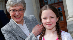 Katherine Zappone launches the plan with the help of nine-year-old Kate Lucy, from Templeogue. Photo: Maxwells