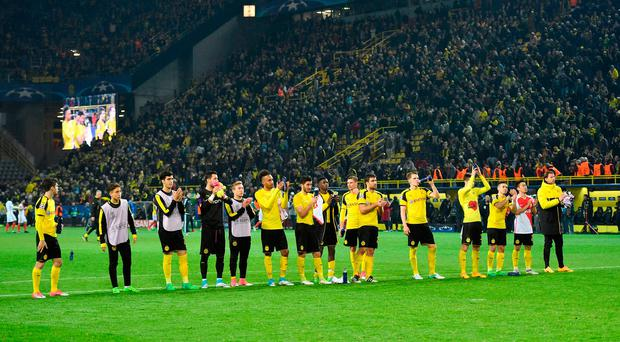 Dortmund players salute their supporters after last night's defeat to Monaco. Photo: AP