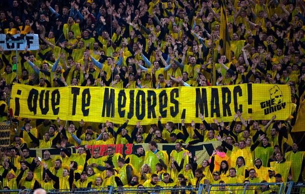 Dortmund fans hold a banner with the message 'Get well, Marc!' during the match. Photo: AP