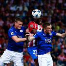 Thomas Teye Partey of Atletico de Madrid wins a header against Robert Huth (L) and Marc Albrighton (R) of Leicester City. Photo: Getty