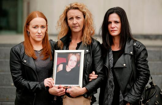 Anna Finnegan's sister Lisa with, left, Caoimhe De Brun and Janice O'Neill outside the Criminal Courts of Justice. Photo: Gerry Mooney