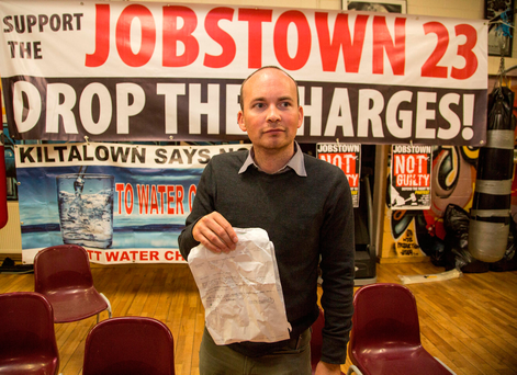 Paul Murphy with court summons at a press conference in West Side Boxing Club, Brookview, Tallaght. Photo: Mark Condren