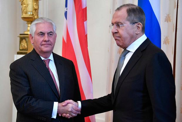 Russian Foreign Minister Sergei Lavrov, right, welcomes US Secretary of State Rex Tillerson before a meeting in Moscow. Photo: Getty Images