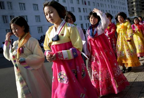 Women wearing traditional dresses walk along Kim Il-sung Square in Pyongyang, North Korea, which marks the 105th anniversary of the birth of the late leader Kim Il-sung on Saturday. Photo: AP