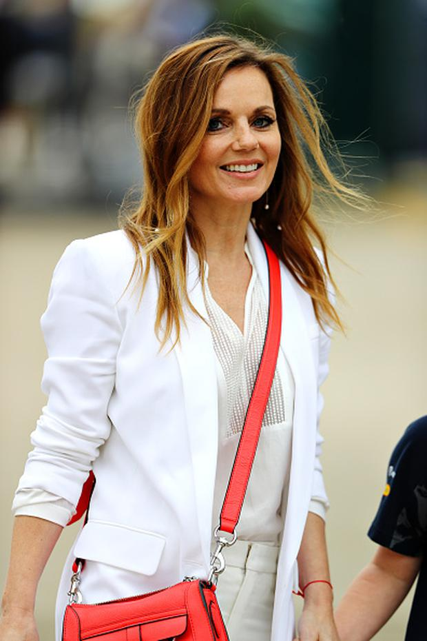 Geri Halliwell walks in the Paddock before the Formula One Grand Prix of Great Britain at Silverstone on July 10, 2016 in Northampton, England. (Photo by Clive Mason/Getty Images)