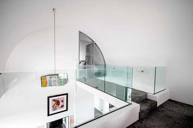 Colin and Ruth Donnelly's Antrim dream house: A bridge connected the mezzanine level to the master bedroom in Colin and Ruth Donnelly's modern contemporary Antrim home: Photo credit: RTE