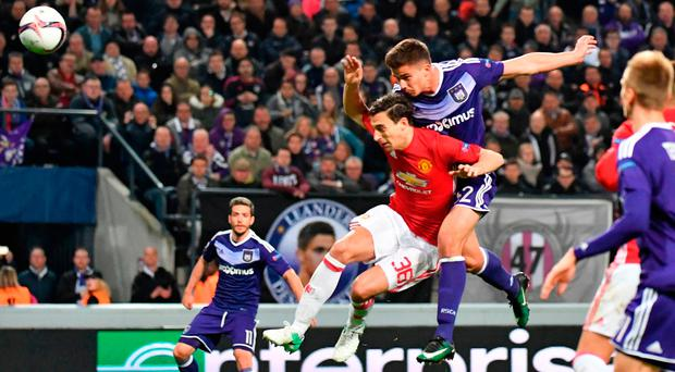 Anderlecht's Leander Dendoncker wins the header ahead of Manchester United's Matteo Darmian to score the equalising goal. Photo: AP