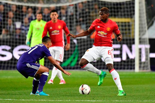 Paul Pogba, right, looks for a way around Anderlecht's Youri Tielemans. Photo: AP
