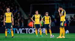 Arsenal players prepare to kick off during their defeat against Crystal Palace which damaged their chances of reaching next season's Champions League. Photo: REUTERS