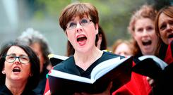 Members of Our Lady's Choral Society, accompanied by the Dublin Handelian Orchestra, during an outdoor performance on Fishamble Street, Dublin, of Handel's 'Messiah'. Photo: PA