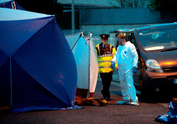 Gardai and forensic officers at the scene of the attack in Tallaght