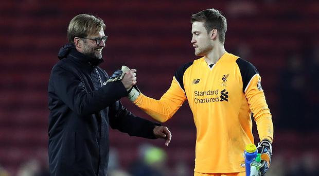 MIDDLESBROUGH, ENGLAND - DECEMBER 14: Liverpool manager Jurgen Klopp shakes hands with Simon Mignolet at full-time following the Barclays Premier League match between Middlesbrough and Liverpool at the Riverside Stadium on December 14, 2016 in Middlesbrough, England. (Photo by Chris Brunskill - AMA/Getty Images)