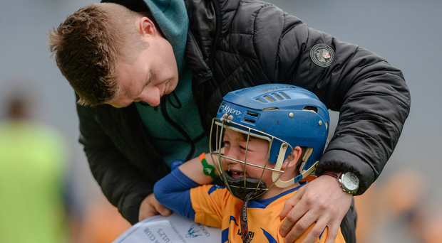 13 April 2017; Joe Canning of Portumna and Galway comforting his nephew Jody Canning representing Portumna GAA Club, Co. Galway, during the Go Games Provincial Days in partnership with Littlewoods Ireland Day 4 at Croke Park in Dublin. Photo by Eóin Noonan/Sportsfile