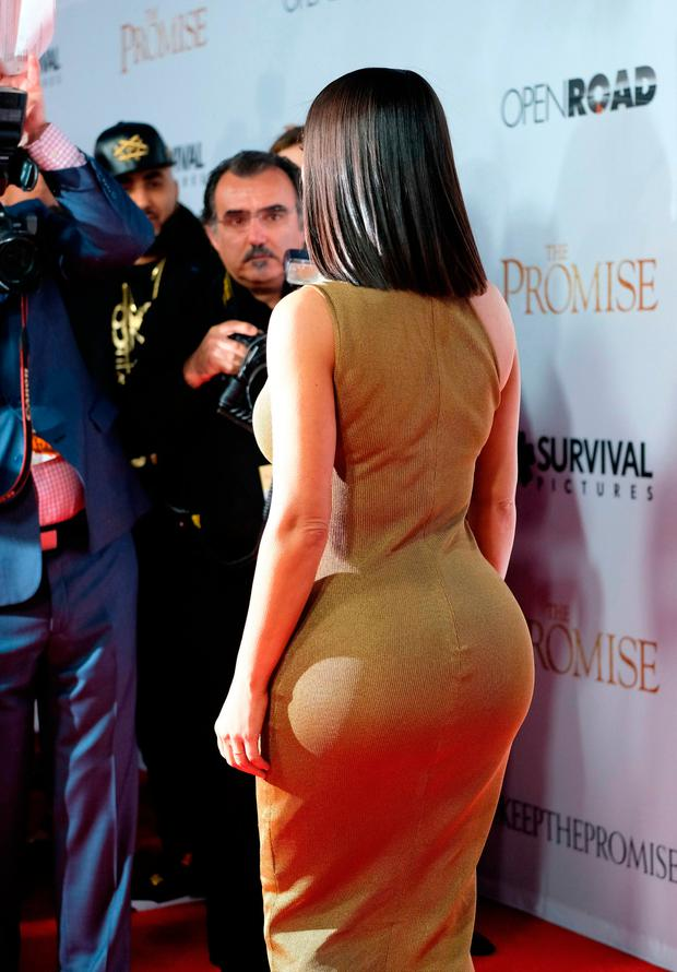 Kim Kardashian attends the premiere of 'The Promise' at the Chinese theatre in Hollywood, on April 12, 2017. / AFP PHOTO / CHRIS DELMASCHRIS DELMAS/AFP/Getty Images