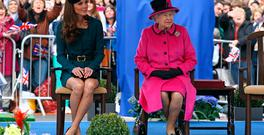Catherine, Duchess of Cambridge (L) and Queen Elizabeth II (R) listen to a welcome speech in Leicester city centre on March 8, 2012 in Leicester, England.