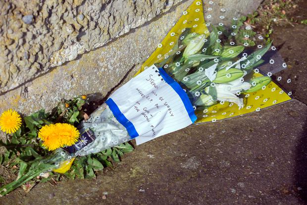 Flowers at the scene of the killing of Stephen Lynch at Brookview Close, Tallaght this morning Credit: Tony Gavin