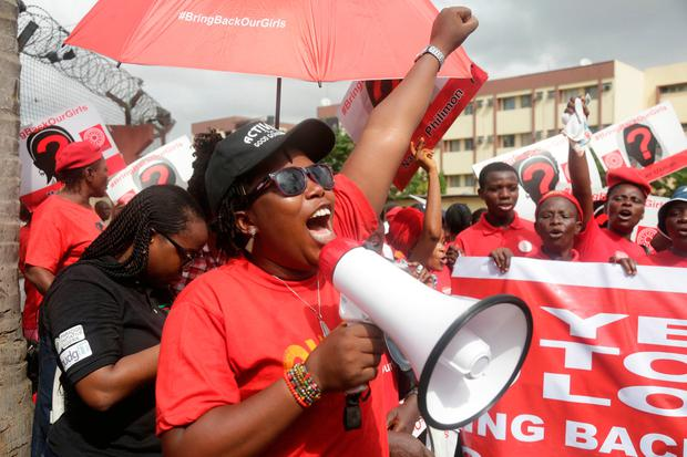 Bring back our girls campaigners chant slogans during a protest ( (AP Photo/Sunday Alamba)