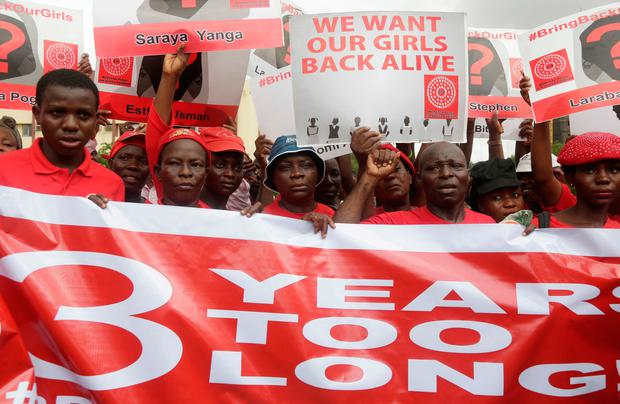 Bring back our girls campaigners chant slogans during a protest (AP Photo/ Sunday Alamba)