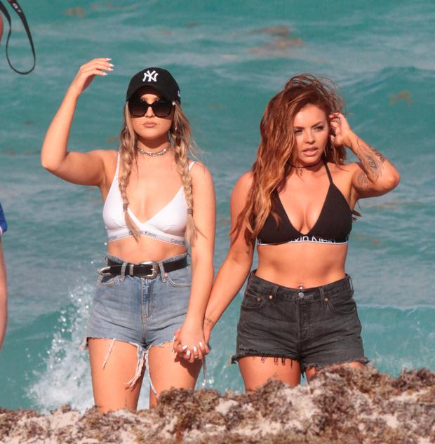 Little Mix Bandmates Perrie Edwards and Jesy Nelson seen taking a stroll on the beach in Miami. Picture: Splash News