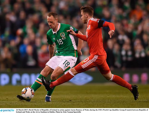 David Meyler in action against Aaron Ramsey of Wales