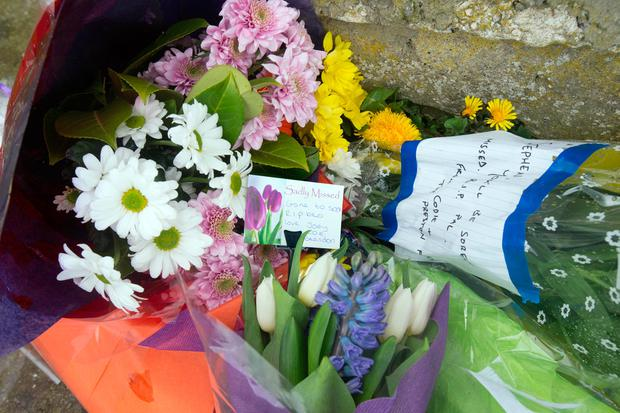 Flowers were laid at the scene of the murder. Photo: Tony Gavin