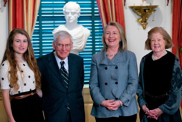 Hillary Clinton with Mr Rooney, his wife Patricia and their granddaughter Photo: Getty