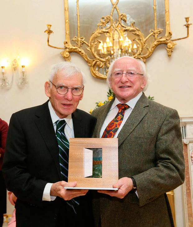 Mr Rooney getting the award for Peace, Reconciliation and Development from President Michael D Higgins in 2013. Photo: Mac Innes