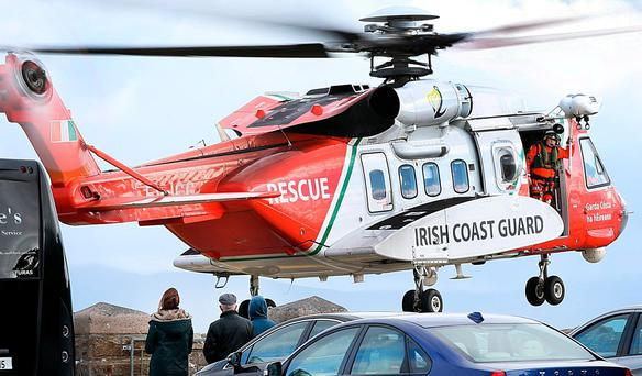 A Coast Guard helicopter takes off at Blacksod Pier. Photo: Steve Humphreys