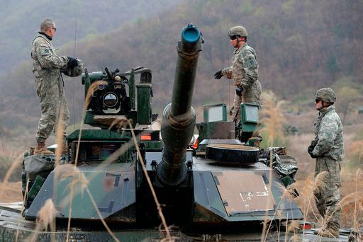 USsoldiers prepare for a military exercise near the border between South and North Korea yesterday in Paju, South Korea. Photo: Chung Sung-Jun/Getty Images.